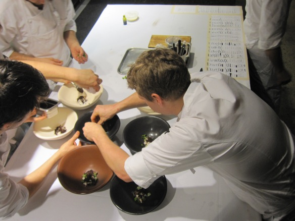The chefs working at the pass