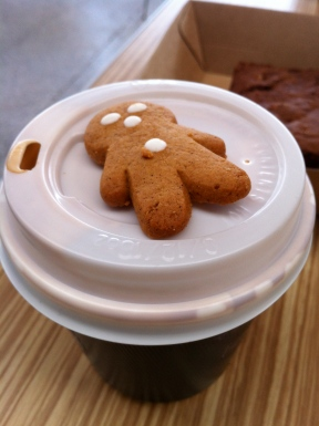 Cute gingerbread man served with each coffee
