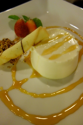 Coconut panacotta with orange sauce